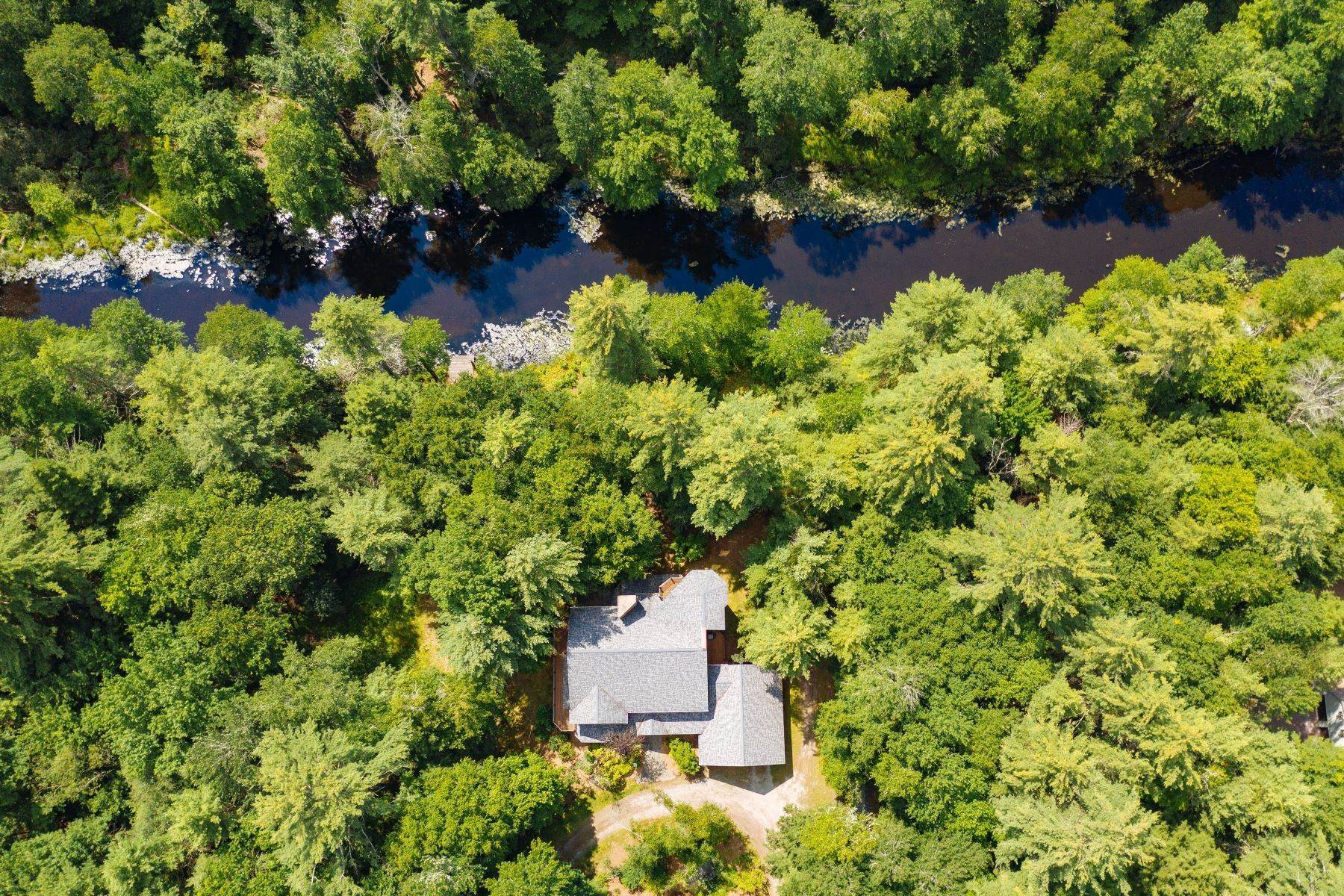 36. Single Family Homes for Sale at Lemons Brook Retreat in Black Lake Estates 80 Lemons Brook Dr Bethel, New York 12720 United States