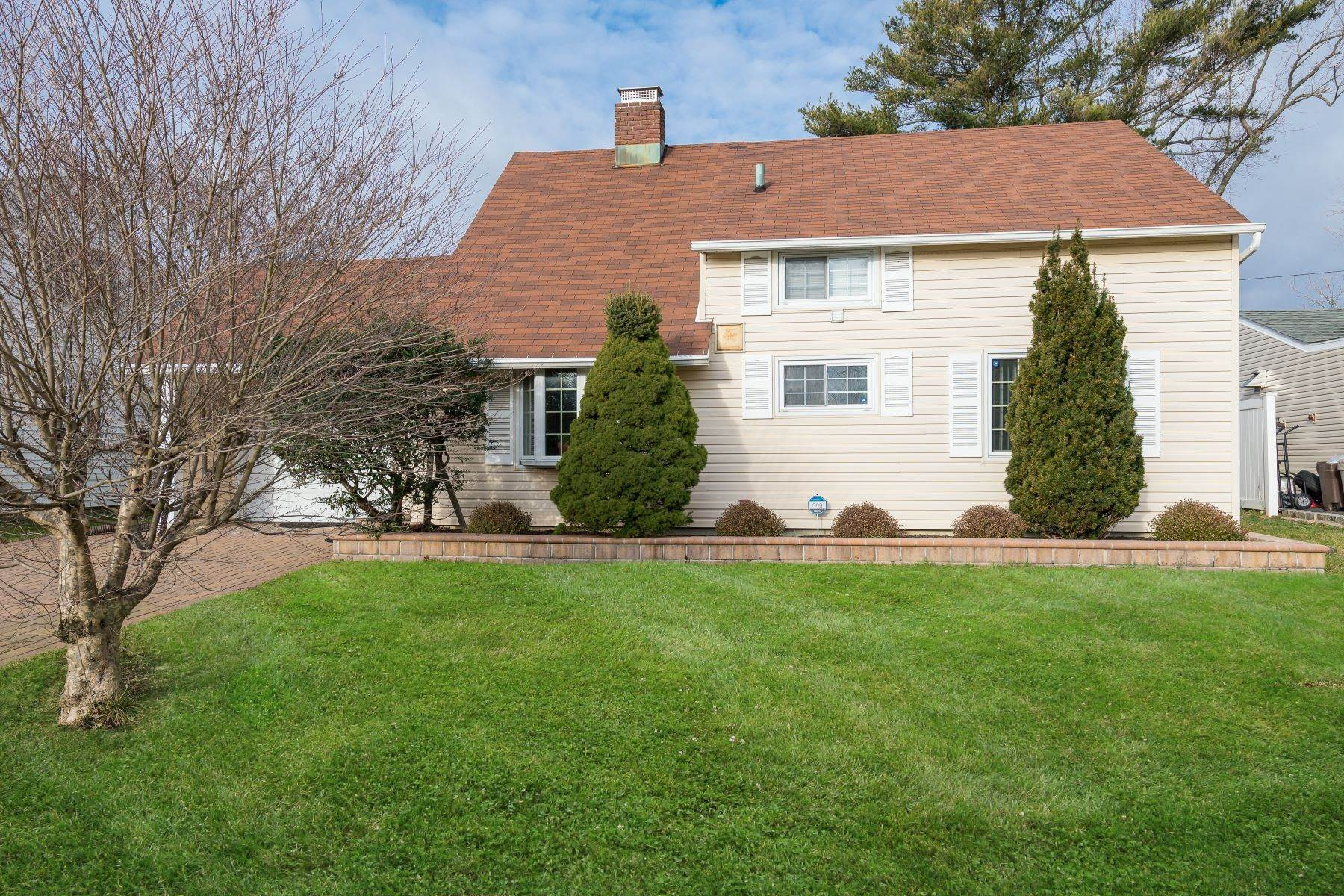 Single Family Homes for Sale at 235 Cypress Lane W, Westbury, Ny, 11590 235 Cypress Lane W Westbury, New York 11590 United States